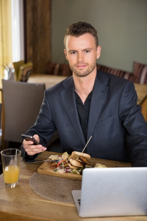 Business man With Mobile phone And Laptop photo