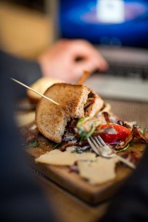 eaten: Half Eaten Sandwich On Wooden Plate Stock Photo