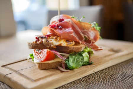 Tasty Parma Ham Sandwich On Wooden Plate photo