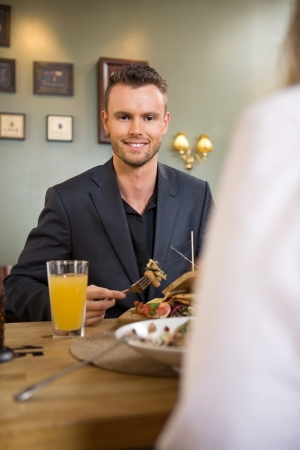 Young Businessman Having Food With Female Colleague Stock Photo - 19811613