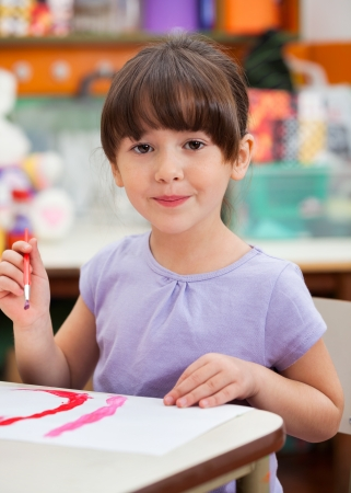 Cute Little Girl Painting In Art Class Stock Photo - 19811594