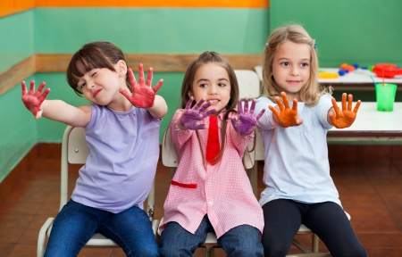 Girl With Friends Showing Colored Palms Stock Photo - 19836619