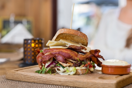 Delicious Sandwich On Wooden Plate Stock Photo - 20169998