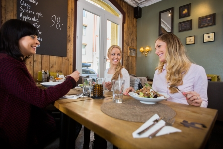 socializing: Women Having Food In Restaurant