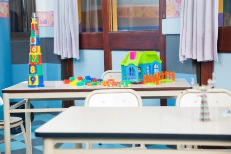 empty classroom: Construction Blocks And House On Desk Stock Photo