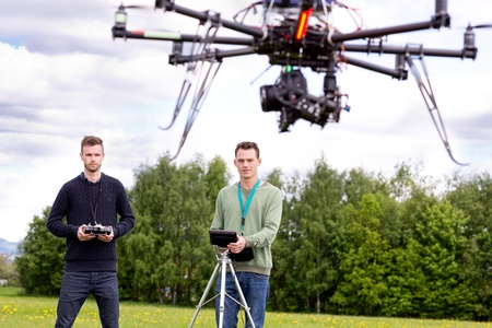 drone: 2 man playing a UAV Photography Drone Stock Photo