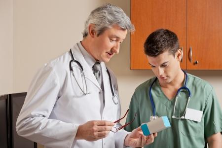 Medical Professionals Looking At Medicine Box photo