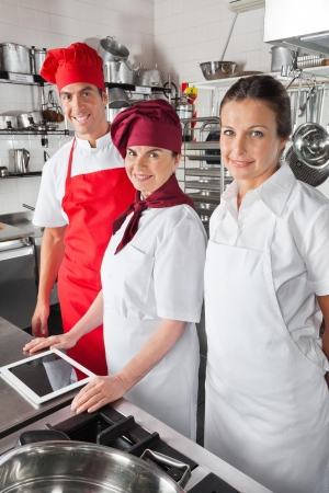 Happy Chefs With Digital Tablet photo