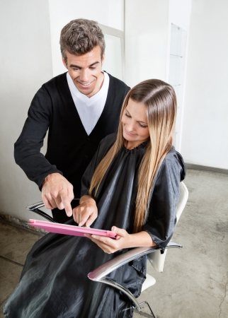 Hairstylist With Client Using Digital Tablet photo