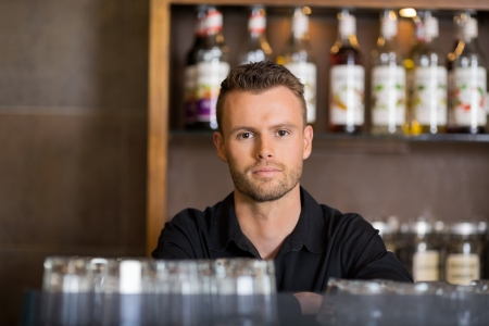 Confident Male Bartender At Cafe photo
