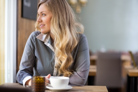 beauty shop: Woman With Coffee Cup At Coffeeshop Stock Photo
