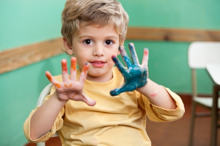 Boy Showing Colored Palms In Art Class Stock Photo - 20419380