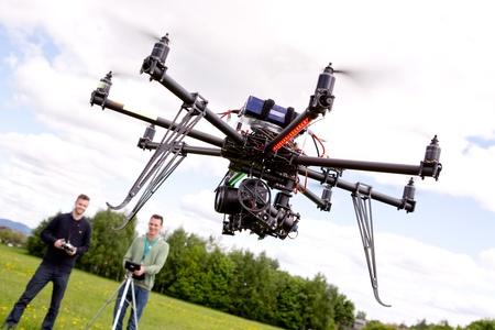 Fotograaf en Pilot met UAV Stockfoto