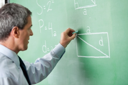 greenboard: Male Professor Writing On Greenboard