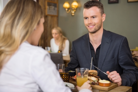 business dinner: Businessman Having Meal With Female