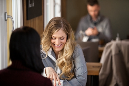 beauty shop: Female Friends Having Coffee At Cafe Stock Photo