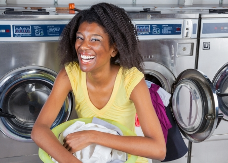 Cheerful Woman With Laundry Basket photo