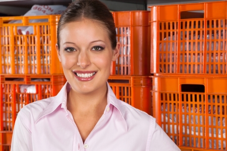 Beautiful Woman Standing Against Baskets Stock Photo - 20633043