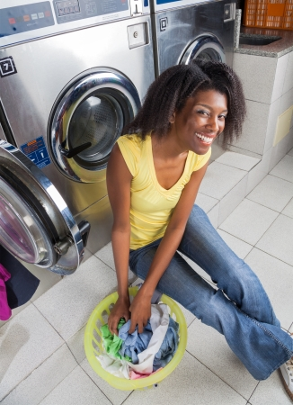 laundromat: Young Woman With Laundry Basket