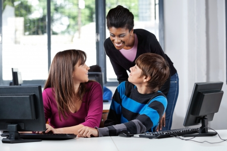 Teacher And Teenage Students In Computer Lab Stock Photo - 20730600