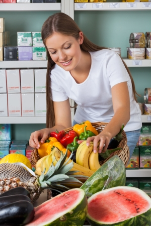 Woman Shopping Fruits And Vegetables In Supermarket photo