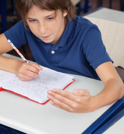 cheat: Schoolboy Cheating During Examination Stock Photo
