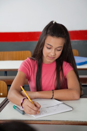 interesting persuasive essay topics High School Students Writing On Paper At Desk