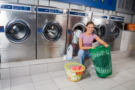 Woman With Baskets Of Clothes At Laundry photo