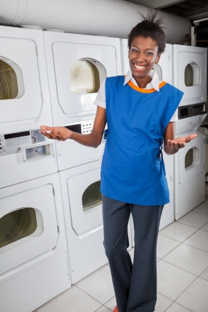 Happy Female Helper Gesturing In Laundry photo