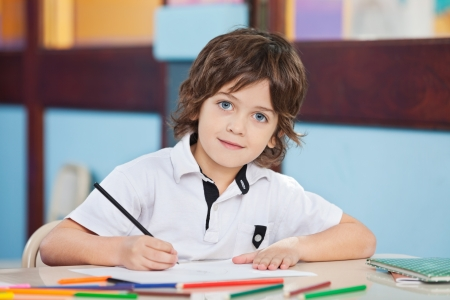one little boy: Boy With Sketch Pen And Paper At Desk