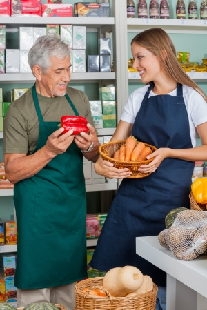 Salesman With Female Colleague Working In Supermarket photo