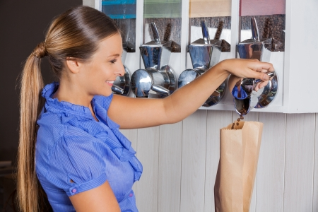 Woman Buying Coffee From Vending Machine In Supermarket Stock Photo - 21872024