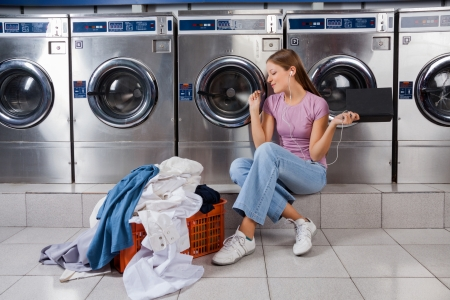 Woman Enjoying Music In Laundry photo