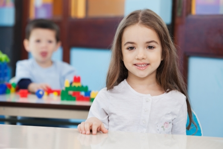 Girl With Friend In Background At Preschool Stock Photo - 21144592