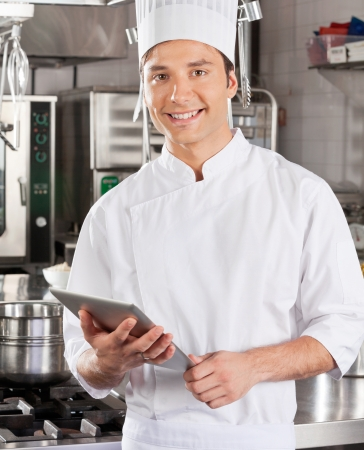 Handsome Chef With Tablet Computer photo