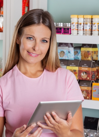 Portrait Of Woman With Digital Tablet In Grocery Store photo