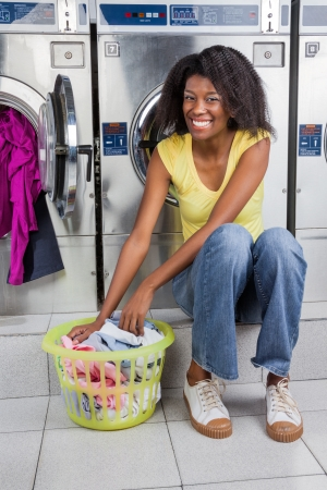 Woman With Basket Of Clothes In Laundry photo