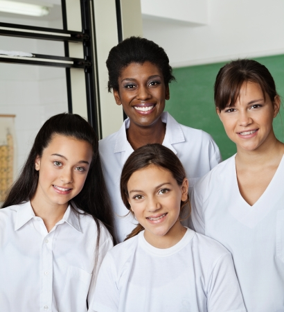 Teacher Standing With Schoolgirls In Lab photo