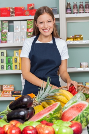 Portrait of happy saleswoman working at supermarket photo