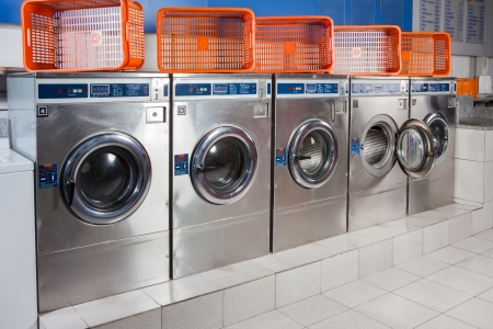 Washing machines and empty baskets in a row