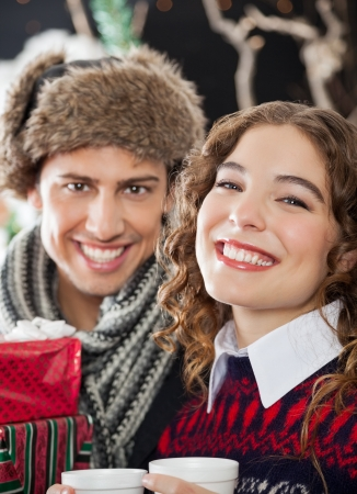 Portrait of happy young couple at Christmas store photo