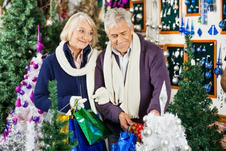Senior couple shopping for decorations in Christmas store photo