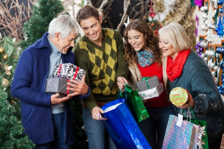 Happy family with shopping bags and presents in Christmas store photo