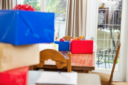 birthday presents: Birthday presents on dining table at party Stock Photo