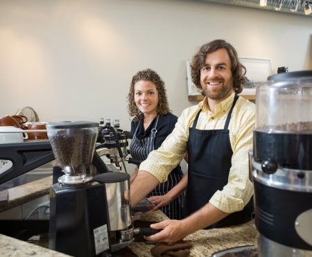 small girl: Portrait of happy colleagues working in coffeeshop