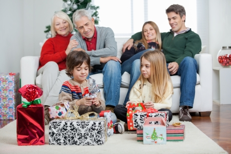 christmas morning: Three generation family with Christmas presents sitting at home