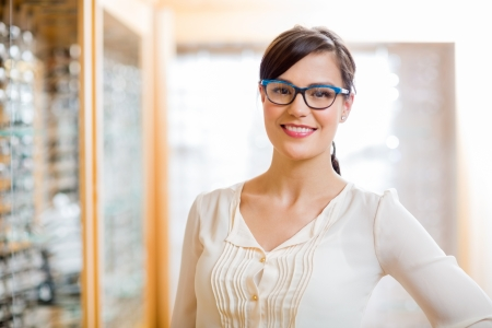 wearing glasses: Portrait of happy female customer wearing glasses in store