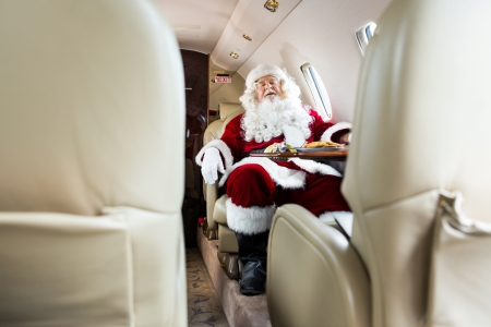Full length of Santa Claus sleeping in private jet photo