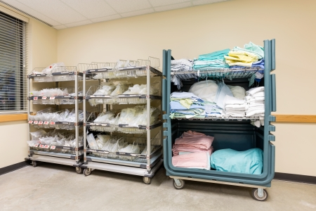 shelves: Large group of hospital supplies arranged in trolleys Stock Photo