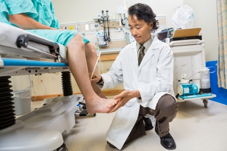 tendon: Full length of neurologist examining patients tendon